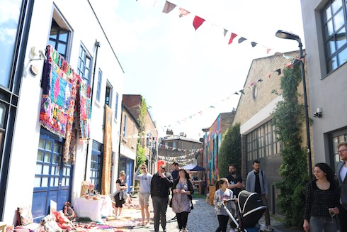 A busy and bustling havelock walk during Dulwich Art Festival. The street is full of people, bunting and stalls