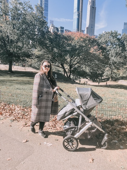 Jodie in New York with her baby Arthur in a pram in Central Park
